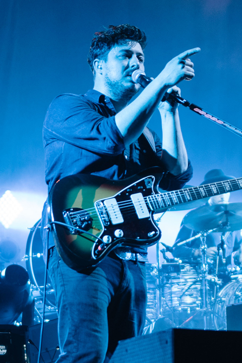 Photo of Mumford & Sons performing live.